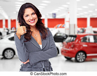 Car dealer woman with thumb.