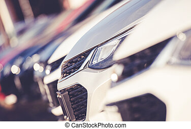 Car Dealership Stock With Line Of New Vehicles.