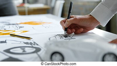 Car designer draw car design in office 4k - Close-up of car...