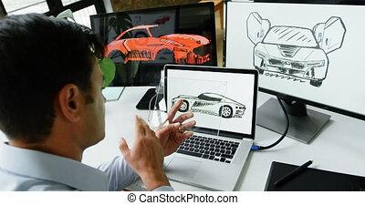 Car designer using glass digital tablet at desk 4k - Car...