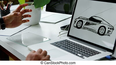 Car designer working on laptop and unseen new technology 4k