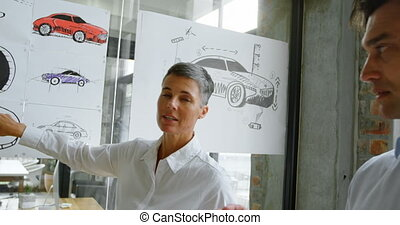 Car designers discussing over car design 4k