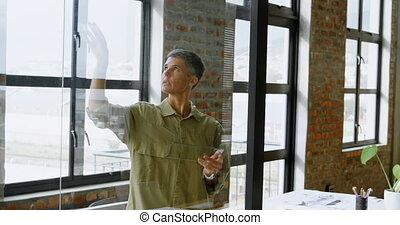 Car designers discussing over glass board 4k - Car designers...