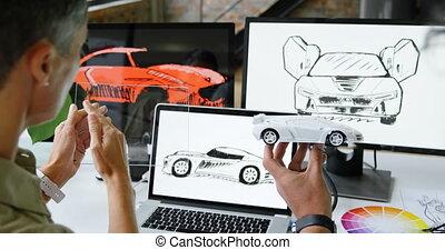 Car designers working at desk 4k