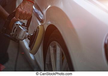 Car detailing series : Worker waxing white car door