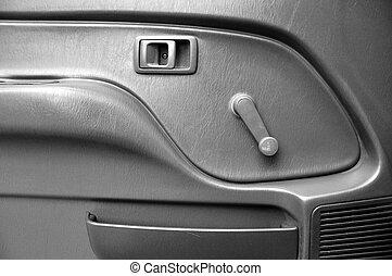 Car door inside with door handle and manual door window...