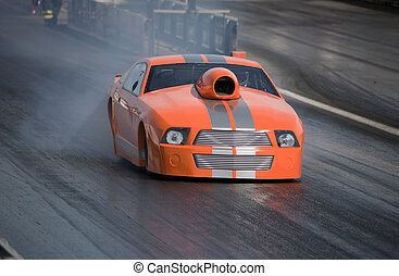Car - Dragster - Brand new orange dragster in fast motion...