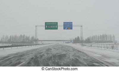 car drive snow blizzard