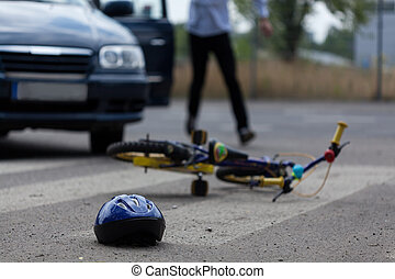 Car driver hitting little biker - Horizontal view of car...