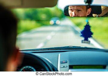 Car Driver in a Mirror