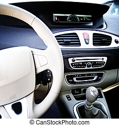 Car driver - Man driving a car. Inside view.