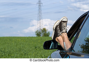 Feet out of vehicle window