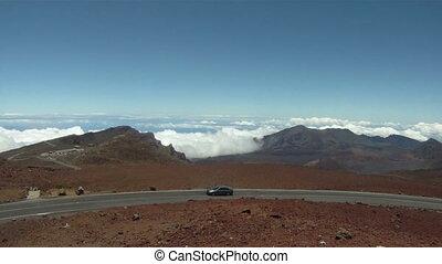 Car drives up Haleakala volcano.