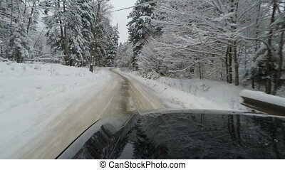 Car driving along snowy road; car mounted camera