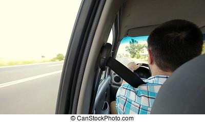 Car Driving Driver - Driver driving car. Back seat POV....