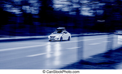 car driving fast dark toned