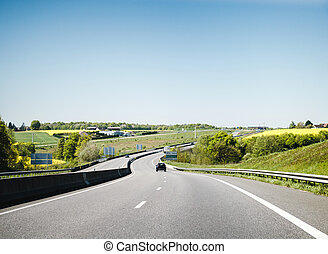 Car driving fast on French highway Montargis