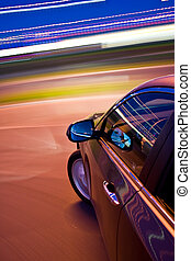 car driving fast in the night