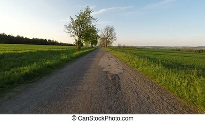 Car driving in spring rural countryside - Car driving in...