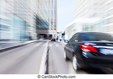 car driving in the business district, motion blur