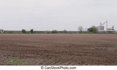 car driving on a road plowed field of granaries