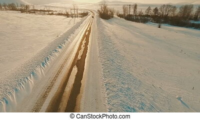 Car driving on icy road at the dusk