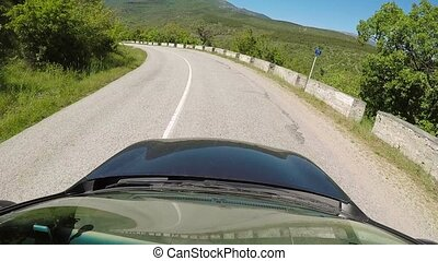 Car driving on mountain road