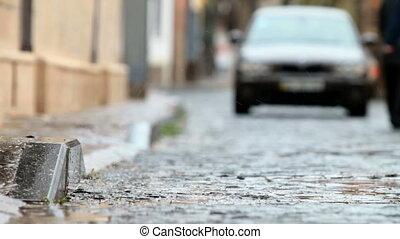 car driving on rainy street