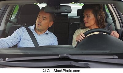 car driving school instructor teaching woman - driver ...