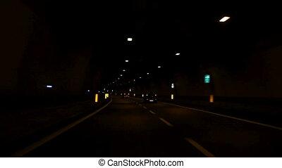 Car driving through tunnel
