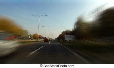 Car driving time laps thru cityscae