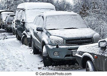 Car during a snowfall in town