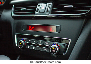 Car elements. Temperature control device on car center console