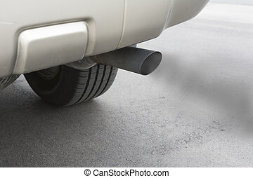 Car emissions exhaust - A car emitts carbon monoxide gas...
