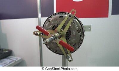 Car engine flywheel repairs at service station internal parts of machine vehicle motor camera movement