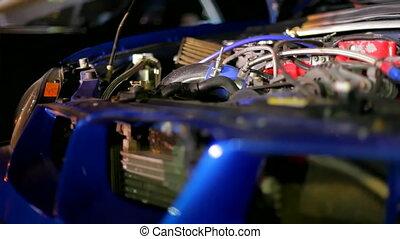 Car engine - Motor expensive sports car. Moving camera.