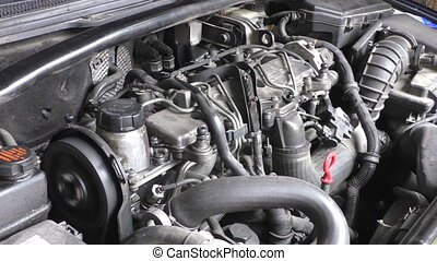 Car engine working - View of car engine compartment with ...