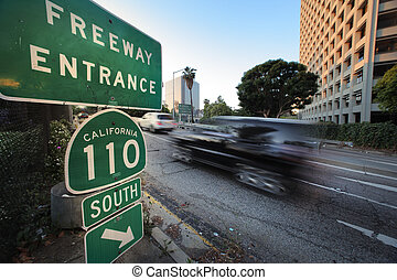 Car entering freeway - 110 South Freeway entrance. Downtown...