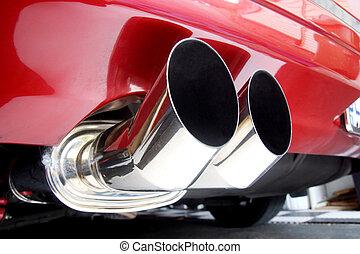 Close up of a car's dual exhaust muffler