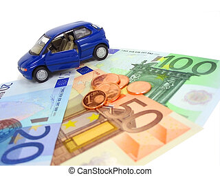 Car expenses - Blue car over euro notes and coins. Shallow ...