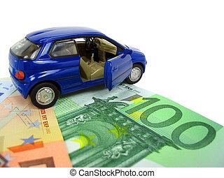 Car expenses - Blue car over euro notes. Shallow DOF