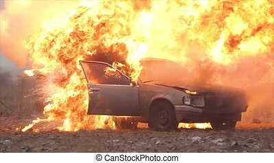 Car Explosion, Car burns in a gray field - Car On Fire,...