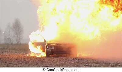 Car Explosion, Front View, Car burns in a gray field - Car...
