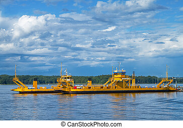 Car ferries. - Two yellow ferries for transportation of cars...