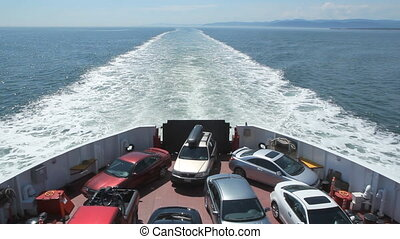 Car ferry. - Cars on a ferry. Crossing the St. Lawrence...