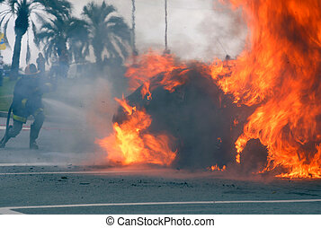 Car fire of a Citroen Xsara being extinguished by a...
