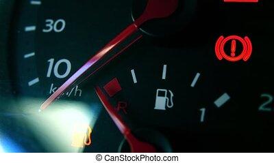 Car fuel gauge and attention sign 4K macro shot - Car fuel...