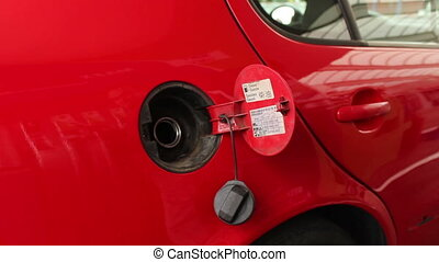 Car Fuels in Gas Station - Automobile is refueling with...