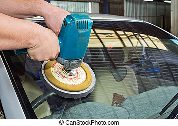 Car Glass polishing with power buffer machine. CAR CARE images. closeup Useful as background for design-works.
