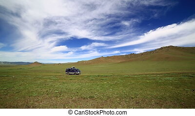 Car going beautiful mongolian offroad - mini Van going at...